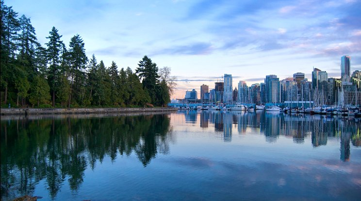 The trees of Stanley Park mirror the downtown Vancouver skyline.